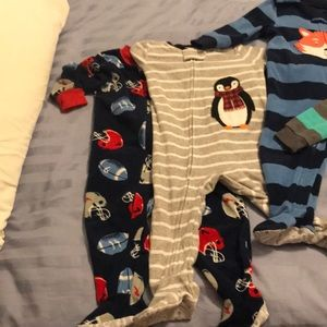 6 Carters Boys gently used 12 Month footed pajamas